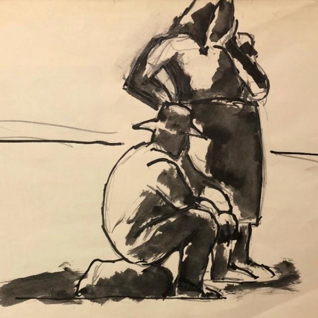 Man sitting on rock, woman standing